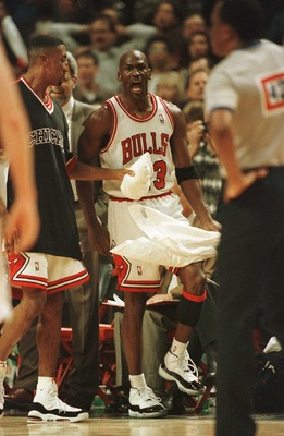 20 Apr 1996:  As teammate Scottie Pippen holds him back, guard Michael Jordan of the Chicago Bulls has words for referee Hugh Hollins, foreground, who called a foul on Jordan with .05 seconds to go in the game allowing Indiana Pacer Eddie Johnson to makea