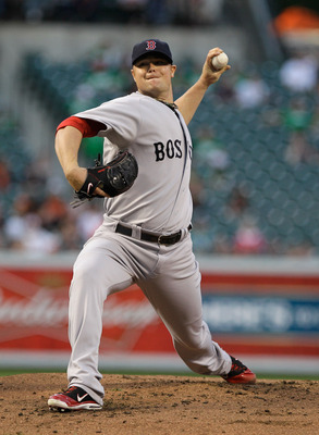 BALTIMORE, MD - APRIL 28:  Starting pitcher Jon Lester #31 of the Boston Red Sox delivers to a Baltimore Orioles batter at Oriole Park at Camden Yards on April 28, 2011 in Baltimore, Maryland.  (Photo by Rob Carr/Getty Images)