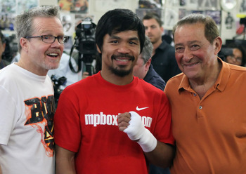 HOLLYWOOD, CA - APRIL 20:  Manny Pacquiao of the Philippines (C) poses with his coach Teddy Roach (L) and promoter Bob Arum (R) during a media workout at the Wild Card Boxing Club on April 20, 2011 in Hollywood, California.  (Photo by Jeff Gross/Getty Ima