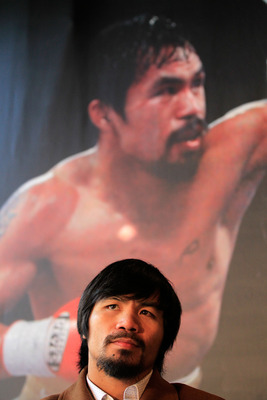 NEW YORK, NY - FEBRUARY 14:  Manny Pacquiao looks on at a press conference to promote his upcoming fight with Shane Mosley at The Lighthouse at Chelsea Piers on February 14, 2011 in New York City.  (Photo by Chris Trotman/Getty Images)