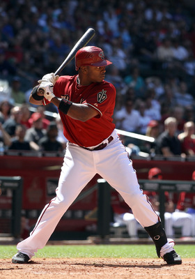 PHOENIX, AZ - MAY 01:  Justin Upton #10 of the Arizona Diamondbacks bats against the Chicago Cubs during the Major League Baseball game at Chase Field on May 1, 2011 in Phoenix, Arizona. The Diamondbacks defeated the Cubs 4-3.  (Photo by Christian Peterse