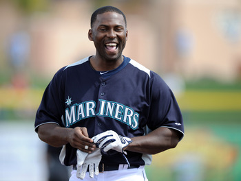 PEORIA, AZ - MARCH 01:  Milton Bradley #15 of the Seattle Mariners smiles as he leaves the field against the Texas Rangers during spring training at Peoria Stadium on March 1, 2011 in Peoria, Arizona.  (Photo by Harry How/Getty Images)