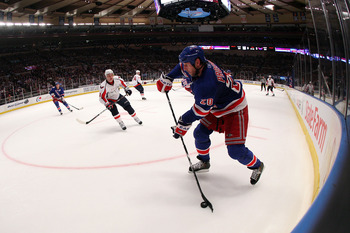 NEW YORK, NY - APRIL 20:  Vaclav Prospal #20 of the New York Rangers moves the puck against the Washington Capitals in Game Four of the Eastern Conference Quarterfinals during the 2011 NHL Stanley Cup Playoffs at Madison Square Garden on April 20, 2011 in