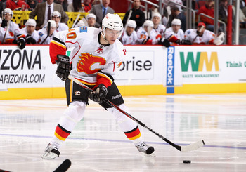 GLENDALE, AZ - MARCH 10:  Alex Tanguay #40 of the Calgary Flames skates with the puck during the NHL game against the Phoenix Coyotes at Jobing.com Arena on March 10, 2011 in Glendale, Arizona.  The Coyotes defeated the Flames 3-0.  (Photo by Christian Pe
