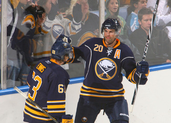 BUFFALO, NY - SEPTEMBER 25: Rob Niedermayer #20 and Tyler Ennis #36 of the Buffalo Sabres celebrate Niedermayer's goal in the second period against the Toronto Maple Leafs at HSBC Arena on September 25, 2010 in Buffalo, New York.  (Photo by Rick Stewart/G