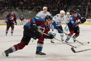 DENVER, CO - JANUARY 18:  Tomas Fleischmann #14 of the Colorado Avalanche takes a shot against the Vancouver Canucks at the Pepsi Center on January 18, 2011 in Denver, Colorado. The Avalanche defeated the Canucks 4-3 in overtime.  (Photo by Doug Pensinger