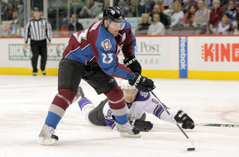 DENVER - APRIL 11:  Milan Hejduk #23 of the Colorado Avalanche beats the defense of Drew Doughty #8 of the Los Angeles Kings as he breaks away to take a shot on goal during NHL action at the Pepsi Center on April 11, 2010 in Denver, Colorado.  (Photo by D