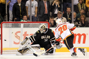 DALLAS, TX - MARCH 09:  Left wing Curtis Glencross #20 of the Calgary Flames scores the game winning goal in the shootout against Kari Lehtonen #32 of the Dallas Stars at American Airlines Center on March 9, 2011 in Dallas, Texas.  (Photo by Ronald Martin