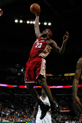 NEW ORLEANS - DECEMBER 29:  LeBron James #23 of the Cleveland Cavaliers dunks the ball against the New Orleans Hornets on December 29, 2007 at the New Orleans Arena in New Orleans, Louisiana.   NOTE TO USER: User expressly acknowledges and agrees that, by