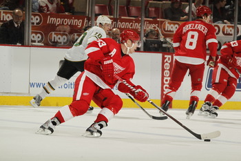 DETROIT, MI - FEBRUARY 24:  Kris Draper #33 of the Detroit Red Wings skates with the puck against the Dallas Stars on February 24, 2011 at Joe Louis Arena in Detroit, Michigan.  (Photo by Gregory Shamus/Getty Images)