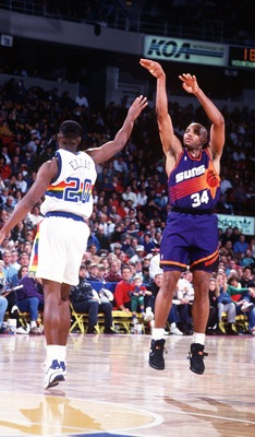 1993:  PHOENIX FORWARD CHARLES BARKLEY SHOOTS OVER DENVER FORWARD LAPHONSO ELLIS DURING THE SUNS GAME AGAINST DENVER. Mandatory Credit: Tim Defrisco/ALLSPORT