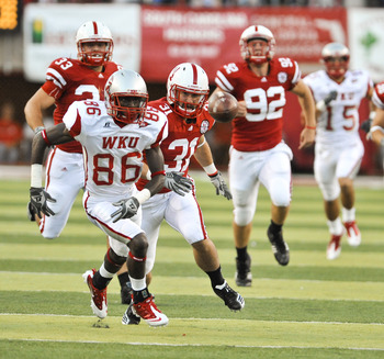 LINCOLN, NE - SEPTEMBER 04: Willie McNeal of the Western Kentucky Hilltoppers and Jase Dean #31 of the Nebraska Cornhuskers run after a mishandled punt during first half action of their game at Memorial Stadium on September 4, 2010 in Lincoln, Nebraska. N