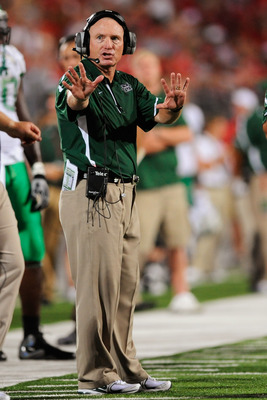 COLUMBUS, OH - SEPTEMBER 2:  Head coach Doc Holliday signals to his players during a game against the Ohio State Buckeyes at Ohio Stadium on September 2, 2010 in Columbus, Ohio.  (Photo by Jamie Sabau/Getty Images)
