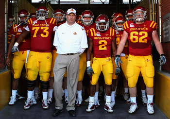 TEMPE, AZ - DECEMBER 31:  (L-R) Reggie Stephens #73, head coach Paul Rhoads, Sedrick Johnson #2 and Nate Frere #62 of the Iowa State Cyclones stand with teammates as they prepare to take the field before the Insight Bowl against the Minnesota Golden Gophe
