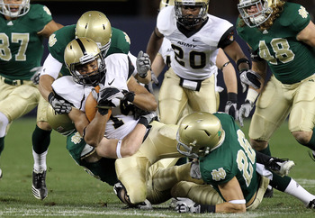 NEW YORK - NOVEMBER 20: Josh Jackson #14 of the Army Black Knights is tackled on a kickoff return by the Notre Dame Fighting Irish at Yankee Stadium on November 20, 2010 in the Bronx borough of New York City.  (Photo by Nick Laham/Getty Images)