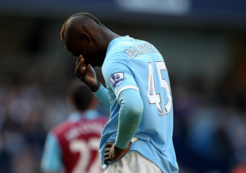 MANCHESTER, ENGLAND - MAY 01:  Mario Balotelli of Manchester City reacts during the Barclays Premier League match between Manchester City and West Ham United at the City of Manchester Stadium on May 1, 2011 in Manchester, England.  (Photo by Alex Livesey/