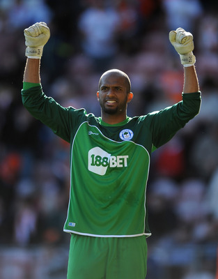 BLACKPOOL, ENGLAND - APRIL 16: Ali Al Habsi of Wigan Athletic celebrates at full-time following the Barclays Premier League match between Blackpool and Wigan Athletic at Bloomfield Road on April 16, 2011 in Blackpool, England.  (Photo by Chris Brunskill/G