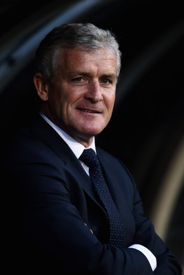 LONDON, ENGLAND - APRIL 27:  Fulham Manager, Mark Hughes smiles during the Barclays Premier League match between Fulham and Bolton Wanderers at Craven Cottage on April 27, 2011 in London, England.  (Photo by Dean Mouhtaropoulos/Getty Images)