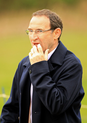 VIRGINIA WATER, ENGLAND - MAY 20:  Aston Villa Manager Martin O'Neill walks down the 5th hole during the first round of the BMW PGA Championship on the West Course at Wentworth on May 20, 2010 in Virginia Water, England.  (Photo by Warren Little/Getty Ima
