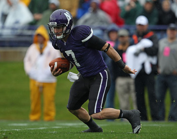 EVANSTON, IL - OCTOBER 23: Dan Persa #7 of the Northwestern Wildcats runs against the Michigan State Spartans at Ryan Field on October 23, 2010 in Evanston, Illinois. Michigan State defeated Northwestern 35-27. (Photo by Jonathan Daniel/Getty Images)