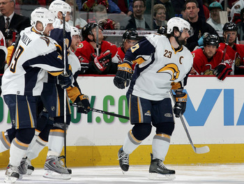 OTTAWA, ON - MAY 16:  Chris Drury #23 of the Buffalo Sabres smiles as he celebrates with teammates after assisting teammate Derek Roy #9 to score in the first nine seconds of the first period of Game 4 of the 2007 Eastern Conference Finals on May 16, 2007