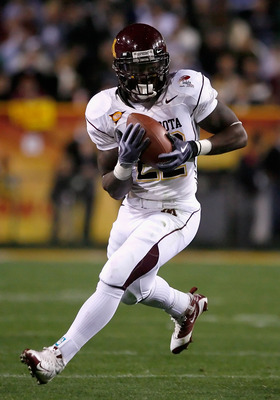 TEMPE, AZ - DECEMBER 31:  Runningback Duane Bennett #22 of the Minnesota Golden Gophers rushes the football against the Iowa State Cyclones during the Insight Bowl at Arizona Stadium on December 31, 2009 in Tempe, Arizona. The Cyclones defeated the Golden
