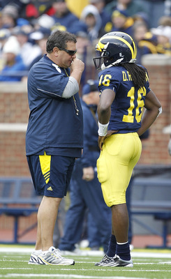 ANN ARBOR, MI - APRIL 16:  Head football coach Brady Hoke talks with Denard Robinson #16 during the annual Spring Game at Michigan Stadium on April 16, 2011 in Ann Arbor, Michigan.  (Photo by Leon Halip/Getty Images)