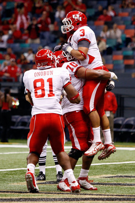 NEW ORLEANS - OCTOBER 17:  Justin Johnson #3 of the Houston Cougars celebrates after a touchdown against the Tulane Green Wave at the Louisiana Superdome on October 17, 2009 in New Orleans, Louisiana.  The Cougars defeated the Green Wave 44-16.  (Photo by