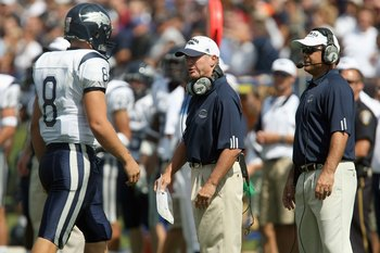 EVANSTON, IL - SEPTEMBER 8:  Head coach Chris Ault of the Nevada Wolf Pack talks with Nick Graziano # 8 against the Northwestern Wildcats on September 8, 2007 at Ryan Field at Northwestern University in Evanston, Illinois. (Photo by Jonathan Daniel/Getty