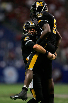 SAN ANTONIO - DECEMBER 1:  Quarterback Chase Daniel #10 of the Missouri Tigers celebrates his touchdown with Jeremy Maclin #9 in the second quarter against the Oklahoma Sooners during the Big 12 Championship at the Alamodome December 1, 2007 in San Antoni