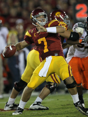 LOS ANGELES, CA - SEPTEMBER 11:  Quarterback Matt Barkley #7 of the USC Trojans throws a pass against the Virginia Cavaliers at Los Angeles Memorial Coliseum on September 11, 2010 in Los Angeles, California. USC won 17-14.  (Photo by Stephen Dunn/Getty Im