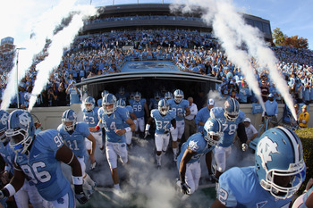 CHAPEL HILL, NC - NOVEMBER 13:  The North Carolina Tar Heels run onto the field before their game against the Virginia Tech Hokies at Kenan Stadium on November 13, 2010 in Chapel Hill, North Carolina.  (Photo by Streeter Lecka/Getty Images)