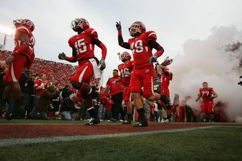 SALT LAKE CITY, UT - NOVEMBER 22:  DeVonte Christopher #15 and Greg Bird #49 of the Utah Utes run onto the field before the game against the BYU Cougars at Rice-Eccles Stadium on November 22, 2008 in Salt Lake City, Utah. (Photo by Jonathan Ferrey/Getty I