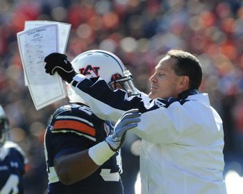 AUBURN, AL - NOVEMBER 06:  Coach Gene Chizik of the Auburn Tigers hugs running back Eric Smith #32 against the Chattanooga Mocs November 6, 2010 at Jordan-Hare Stadium in Auburn, Alabama.  (Photo by Al Messerschmidt/Getty Images)