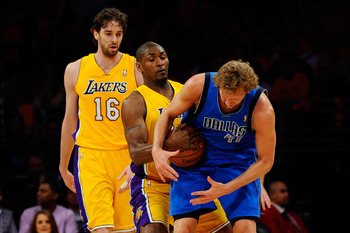 LOS ANGELES, CA - MAY 02:  Dirk Nowitzki #41 of the Dallas Mavericks holds onto the ball as Ron Artest #15 of the Los Angeles Lakers attempts to steal it in the first quarter of Game One of the Western Conference Semifinals in the 2011 NBA Playoffs at Sta