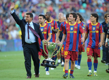 BARCELONA, SPAIN - AUGUST 25:  Former Barcelona president Joan Laparta holds the 2009-2010 La Liga trophy with Leo Messi during a lap of honour before the Joan Gamper Trophy match between Barcelona and AC Milan at Camp Nou stadium on August 25, 2010 in Ba