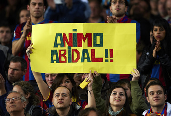 BARCELONA, SPAIN - MARCH 19:  Barcelona fans display a banner in support of Eric Abidal before the La Liga match between Barcelona and Getafe at Camp Nou on March 19, 2011 in Barcelona, Spain. Barcelona won 2-1.  (Photo by Manuel Queimadelos Alonso/Getty