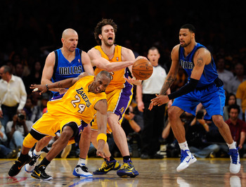 LOS ANGELES, CA - MAY 02:  Kobe Bryant #24 of the Los Angeles Lakers falls down as Pau Gasol #16 looses the ball in front of Jason Kidd #2 and Tyson Chandler #6 of the Dallas Mavericks late in the fourth quarter in Game One of the Western Conference Semif