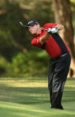 HILTON HEAD ISLAND, SC - APRIL 24:  Tommy Gainey hits a shot on the 13th hole during the final round of The Heritage at Harbour Town Golf Links on April 24, 2011 in Hilton Head Island, South Carolina.  (Photo by Streeter Lecka/Getty Images)