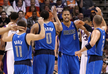PHOENIX, AZ - MARCH 27:  Tyson Chandler #6 of the Dallas Mavericks high fives teammates Jose Barea #11, Shawn Marion #0 and Jason Kidd #2 after scoring against the Phoenix Suns during the NBA game at US Airways Center on March 27, 2011 in Phoenix, Arizona