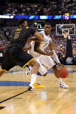 TAMPA, FL - MARCH 19:  Terrence Jones #3 of the Kentucky Wildcats drives against Kevin Jones #5 of the West Virginia Mountaineers during the third round of the 2011 NCAA men's basketball tournament at St. Pete Times Forum on March 19, 2011 in Tampa, Flori