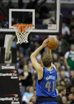 WASHINGTON, DC - FEBRUARY 26: Dirk Nowitzki #41 of the Dallas Mavericks shoots a free throw against the Washington Wizards at the Verizon Center on February 26, 2011 in Washington, DC. NOTE TO USER: User expressly acknowledges and agrees that, by download
