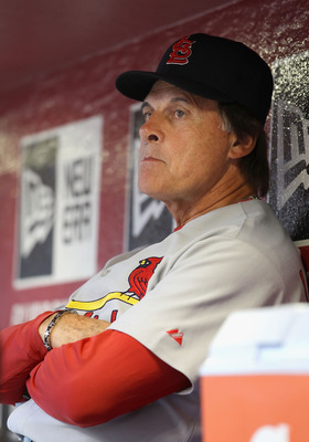 PHOENIX, AZ - APRIL 12:  Manager Tony La Russa of the St. Louis Cardinals sits in the dugout during the Major League Baseball game against the Arizona Diamondbacks at Chase Field on April 12, 2011 in Phoenix, Arizona.   The Diamondbacks defeated the Cardi