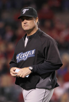 ANAHEIM, CA - APRIL 08:  Toronto Blue Jays manager John Farrell walks back to the dugout in the eighth inning against the Los Angeles Angels of Anaheim at Angel Stadium of Anaheim on April 8, 2011 in Anaheim, California. The Blue Jays defeated the Angels