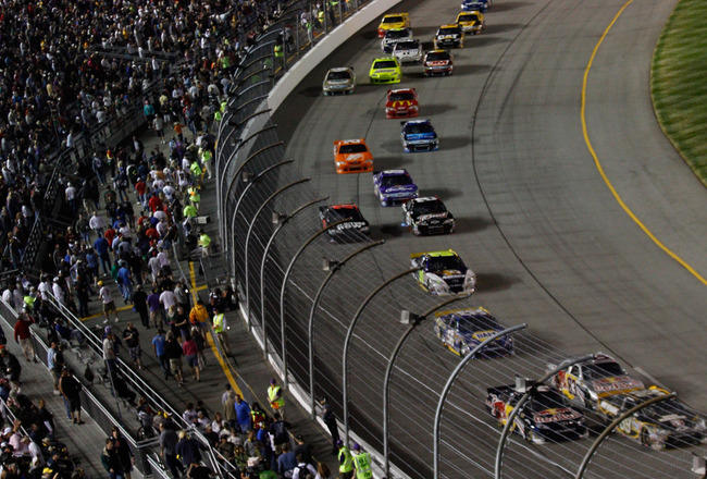 RICHMOND, VA - APRIL 30:  A view of race action during the NASCAR Sprint Cup Series Crown Royal Presents The Matthew & Daniel Hansen 400 at Richmond International Raceway on April 30, 2011 in Richmond, Virginia.  (Photo by Chris Graythen/Getty Images)
