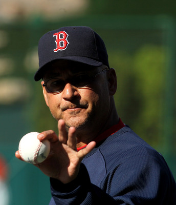ANAHEIM, CA - APRIL 23:  Manager Terry Francona of the Boston Red Sox points to a fan with the baseball before the game with the Los Angeles Angels of Anaheim on April 23, 2011 at Angel Stadium in Anaheim, California.    (Photo by Stephen Dunn/Getty Image