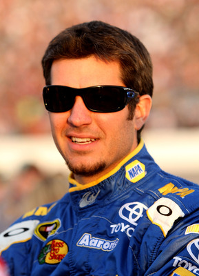 RICHMOND, VA - APRIL 30: Martin Truex Jr., driver of the #56 NAPA Auto Parts Toyota waits on the grid prior to the NASCAR Sprint Cup Series Crown Royal Presents The Matthew & Daniel Hansen 400 at Richmond International Raceway on April 30, 2011 in Richmon