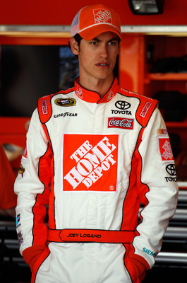 RICHMOND, VA - APRIL 29:  Joey Logano, driver of the #20 The Home Depot Toyota, stands in the garage area during practice for the NASCAR Sprint Cup Series Crown Royal Presents The Matthew & Daniel Hansen 400 at Richmond International Raceway on April 29,