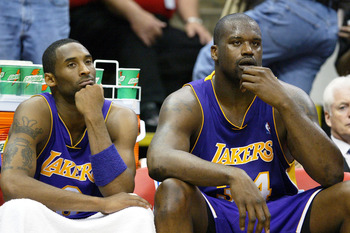 MINNEAPOLIS - MAY 23:  Kobe Bryant #8 and Shaquille O'Neal #34 of the Los Angeles Lakers look on in the second half of Game two of the Western Conference Finals against the Minnesota Timberwolves during the 2004 NBA Playoffs on May 23, 2004 at Target Cent