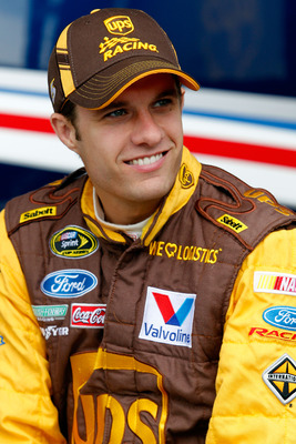 TALLADEGA, AL - APRIL 15:  David Ragan, driver of the #6 UPS Ford, sits in the garage area during practice for the NASCAR Sprint Cup Series Aaron's 499 at Talladega Superspeedway on April 15, 2011 in Talladega, Alabama.  (Photo by Todd Warshaw/Getty Image